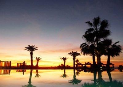 Single-Golfreisen: Agadir (Robinson Club, Pool bei Sonnenuntergang)